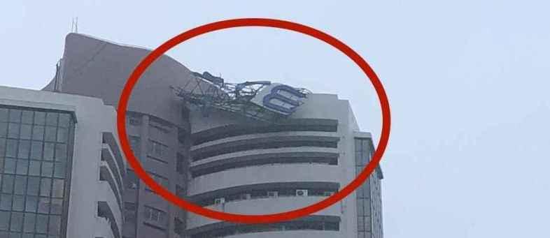 Heavy rain topples signage of Bombay Stock Exchange building in Mumbai.jpg