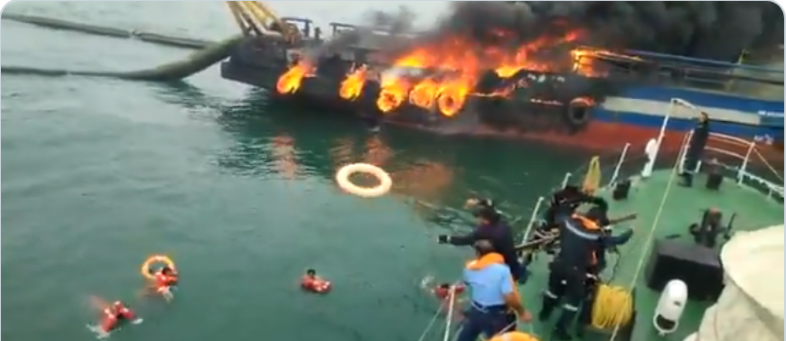 Visakhapatnam - Massive fire on ship, crew jumps into water to save lives--.png