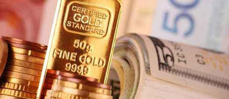 World Gold price falls 40 dollar after hits 7 year high.jpg