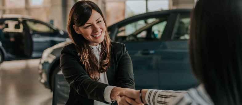 Women handle driver seat in car dealership.jpg
