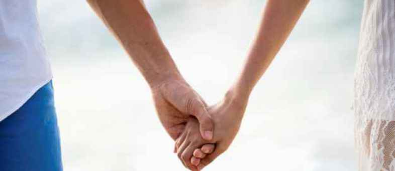 close-up-lover-couple-holding-hands_40936-58.jpg